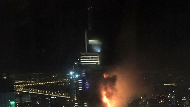 Smoke and flames pour out of a residential building as a fire runs up some 20 stories of the high rise in Dubai, United ...