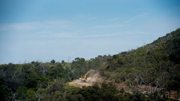 Earth-moving equipment working in Kennett River. A firefighting crew from New Zealand are expected to arrive at the fire ...