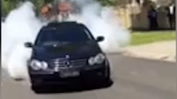 A car doing a burnout as part of the wedding 'celebrations'.