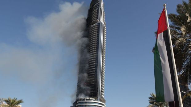 Smoke billows from the Address Downtown skyscraper in Dubai on Friday.