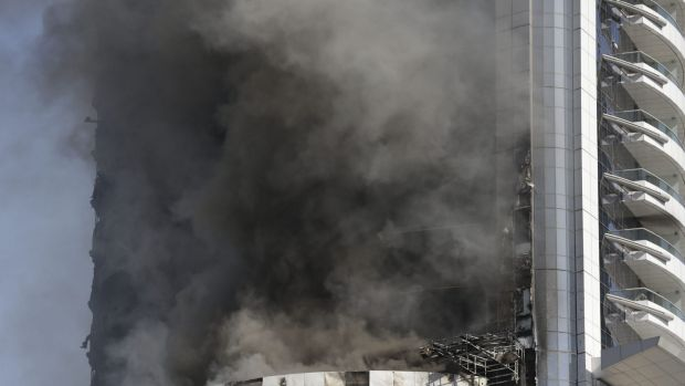 A fire burns in the Address Downtown skyscraper in Dubai, United Arab Emirates on Friday.