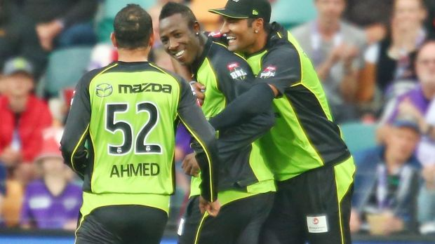 Too good: Andre Russell of the Thunder celebrates with his teammates.