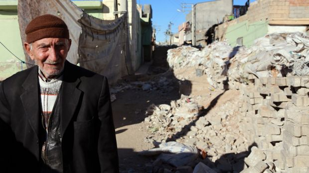 A man stands amid the rubble in Nusaybin, Turkey.