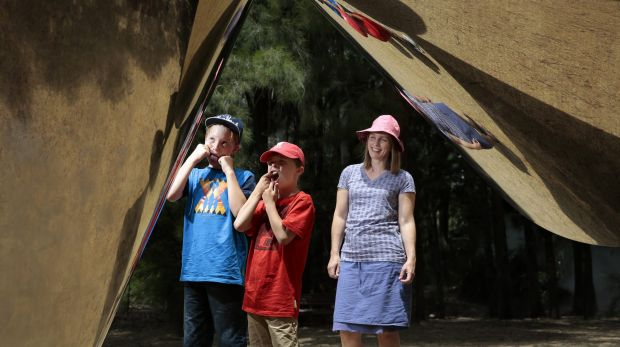 From left, brothers Ben Davies, 11, and James Davies, 8, of Melbourne with mum Melanie Davies, clowning around with ...