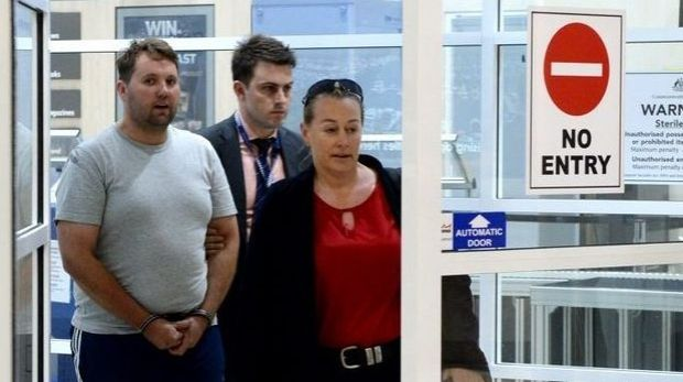 Jason Wayne Greatbatch, 35 from South Australia, arrives at Mackay airport with detectives. He is facing charges ...