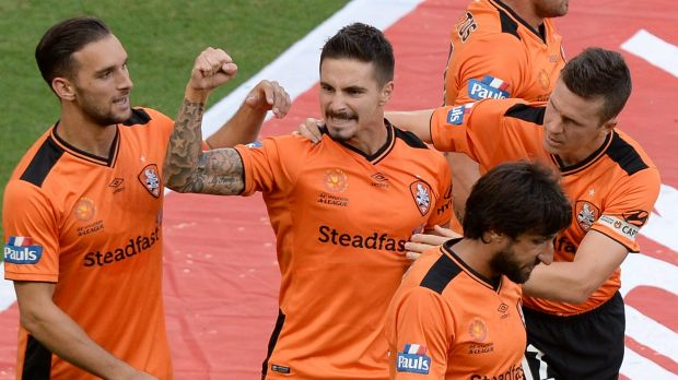 Brisbane's Jamie Maclaren celebrates scoring against Perth.