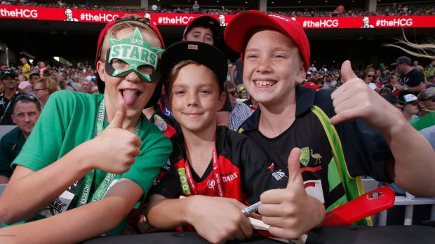 All smiles: Young fans getting ready for the big clash.
