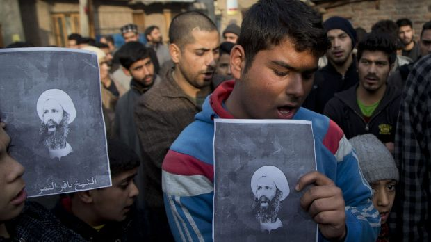 Kashmiri Shiite Muslims hold portraits of the executed cleric Sheikh Nimr al-Nimr during a protest.