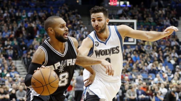 On the ball: Patty Mills was promoted to the Spurs' starting line-up.