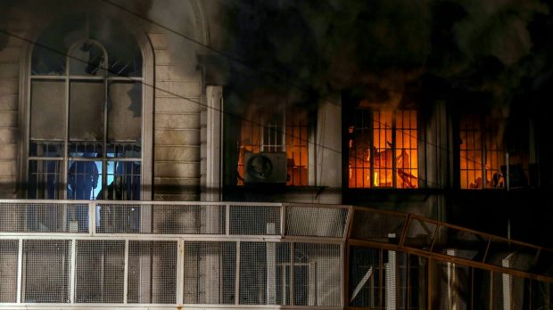 Smoke billows from the windows of the burning Saudi embassy in Tehran following a protest by Iranian activists.