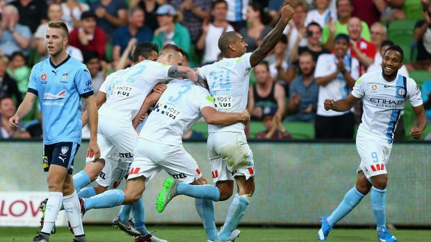 On target: Melbourne City's Aaron Hughes celebrates after scoring a goal against Sydney FC on Saturday night.