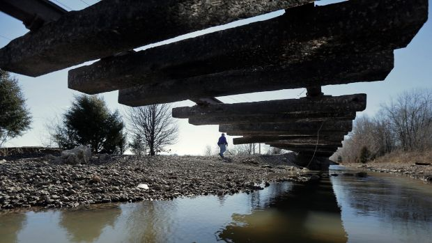 A span of soil missing from a section of train tracks in St Louis, Missouri, after flooding from the Meramec River.