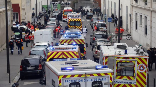 January 7, 2015: Ambulances gather in the street outside the French satirical newspaper Charlie Hebdo's office after ...