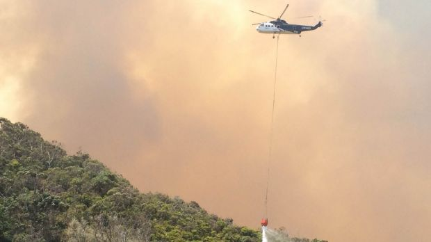 A helicopter tackles the blaze that destroyed numerous homes in the Wye River fire on Christmas Day.