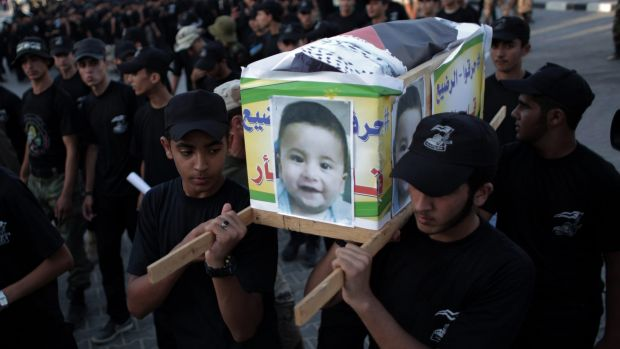 "The coffin carrying the body of one-and-a-half year old Ali Dawabsheh included the Arabic inscription: ""They burned the ..."