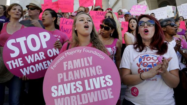 Planned Parenthood supporters attend a September rally in Los Angeles to campaign for access to reproductive health care.