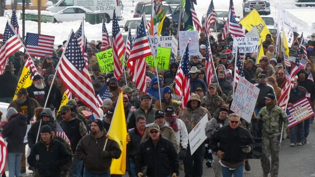 Protesters march in support of an Oregon ranching family facing jail time for arson in Burns, Oregon, ahead of the ...