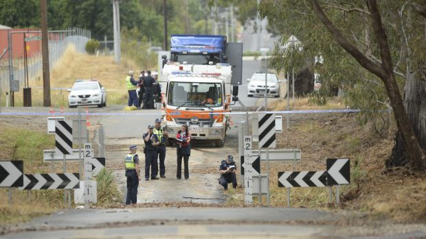 Police on the scene at Whiteheads creek in Seymour, where a man drowned after driving his car into flood waters.