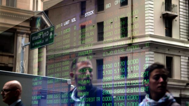 A reflection of passersby and the ASX stock board on Bridge Street in Sydney.
