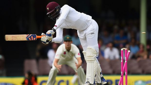 Skittled: Australian paceman James Pattinson rattles the stumps of West Indian batsman Carlos Brathwaite.