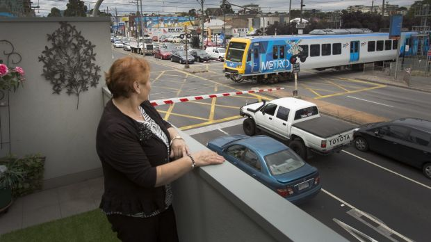 Mella Gigis bought next to the rail line in Preston in 2013 and says she has slowly been driven mad by car and train noise.