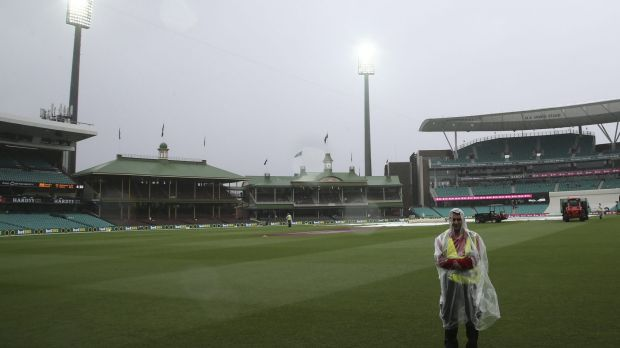 Wet day: A security guard stands on the field at the Sydney Cricket Ground as play is abandoned.