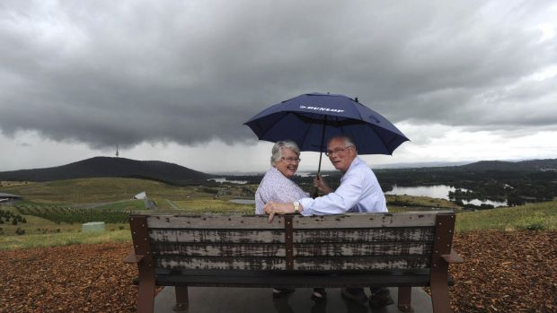 Barbara and Ric Kells, of the Blue Mountains, came prepared for wet weather at the National Arboretum.