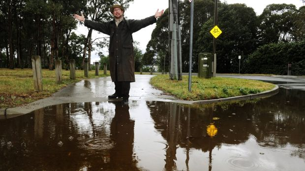 Tourist Andrew Platt was prepared for Canberra's wet weather conditions on Monday.