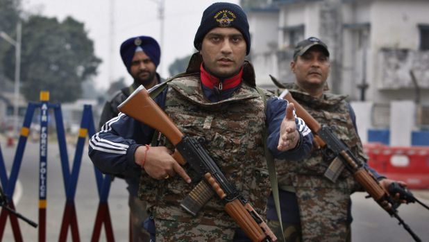 Soldiers patrol the Pathankot air base on Monday.