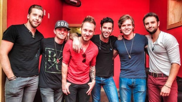 US country music singer Craig Strickland (centre, in black t-shirt and jeans), frontman for band Backroad Anthem, was ...