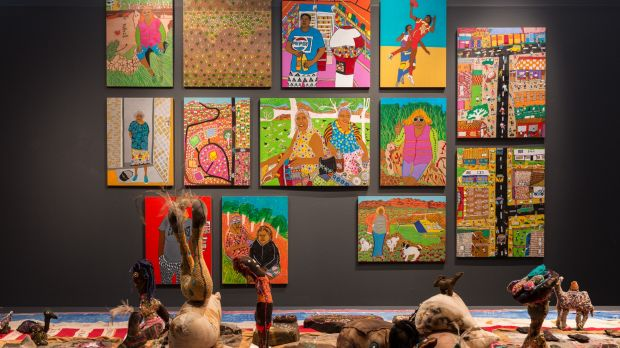 """""""Naive"""" paintings of outback suburbia by the Tangentyere Artists from town camps around Alice Springs."""