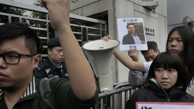 A protester with  a photo of missing bookseller Lee Bo in Hong Kong on Sunday.