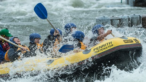 Kayakers continue to train at Penrith Whitewater amid another wet day in eastern NSW.