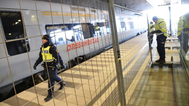 A temporary fence erected between domestic and international train tracks at Hyllie train station in southern Malmo, ...