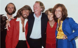 The Bee Gees with brother Andy Gibb and manager Robert Stigwood, New York, 1979, L-R Maurice Gibb, Barry Gibb, Maurice ...