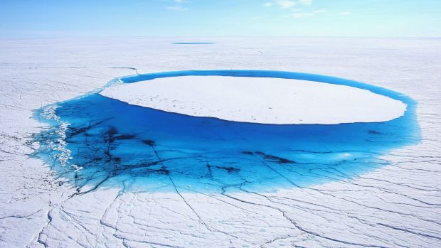 Water lies on part of the glacial ice sheet that covers about 80 per cent of Greenland.