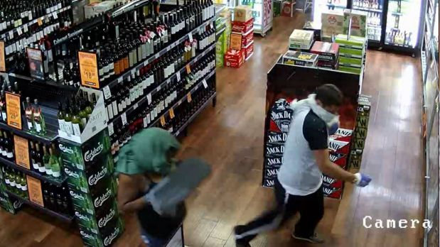 Police are searching for three people after an aggravated robbery at a Gold Creek bottle shop.