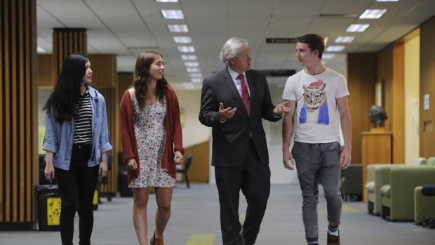 Newly appointed vice-chancellor Professor Brian Schmidt meets new ANU students, from left, Hannah Chan, Therese McMahon ...