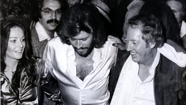 Robert Stigwood, right, with Barry and Linda Gibb at the Saturday Night Fever launch party.