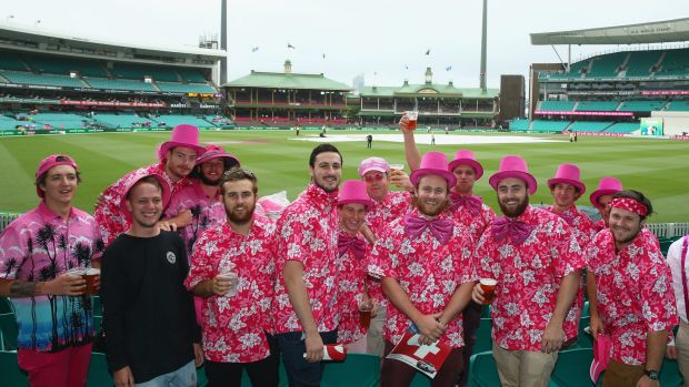 Members of the crowd dressed in pink for Jane McGrath Day pose as they wait for play to start on day three of the third ...