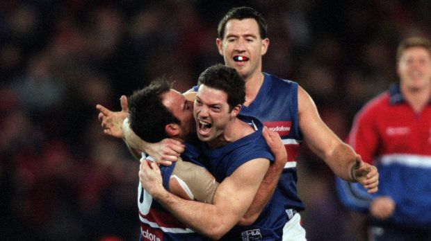 Nathan Eagleton and Rohan Smith of the Western Bulldogs celebrate at the final siren after they defeated Essendon in ...