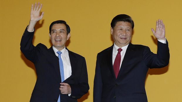Chinese President Xi Jinping, right, and Taiwanese President Ma Ying-jeou wave to the media at the Shangri-la Hotel in ...