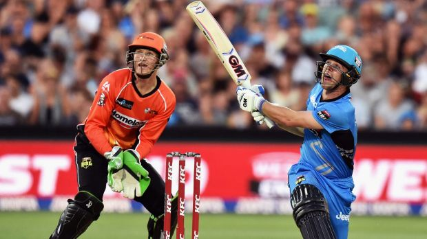Man of the match Travis Head of the Adelaide Strikers hits a six.
