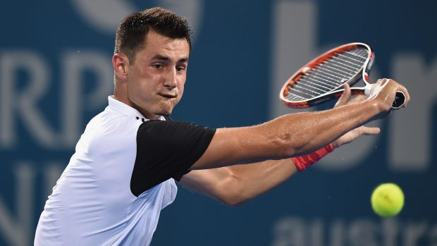 Bernard Tomic plays a backhand against Nicolas Mahut of France.