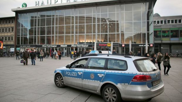 Overwhelmed: a police car passes the central railway station in Cologne, Germany.