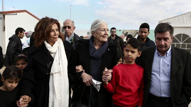 Vanessa Redgrave is escorted by Athens' Mayor Giorgos Kaminis (right) and Greek actress Mini Denissi at Eleonas refugee ...