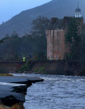 Abergeldie Castle sits precariously on the edge of the River Dee after a storm surge swept away the river bank.