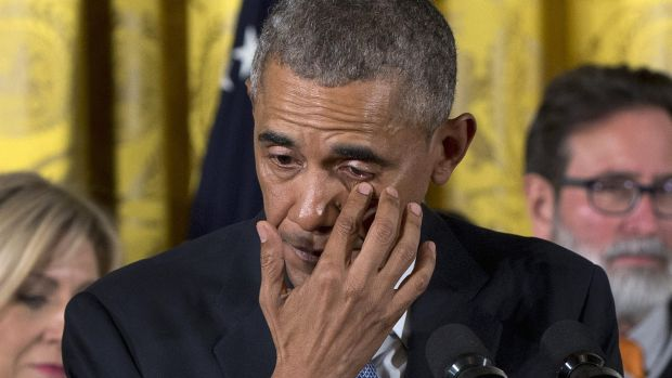 President Barack Obama wipes tears from his eyes as he speaks in the White House on Tuesday, about his determination to ...