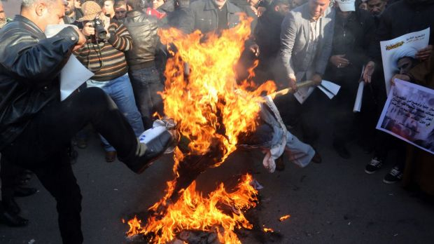 Followers of Shiite cleric Muqtada al-Sadr burn an effigy of King Salman of Saudi Arabia in Baghdad, Iraq.