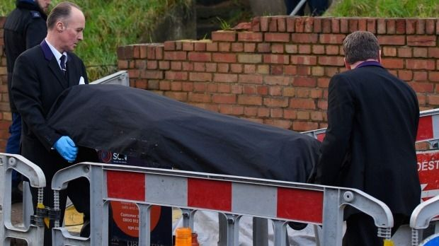 Two bodies were removed from the house on Tuesday.